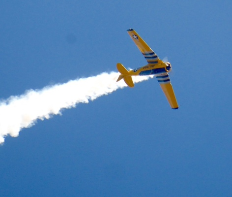 Slider airshow yellow plane in flight